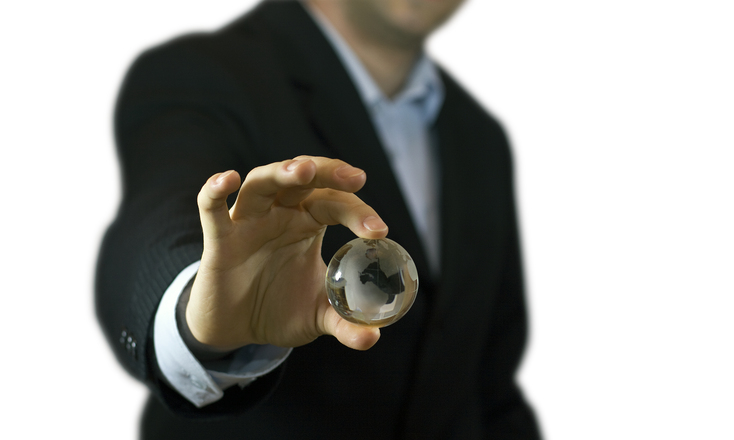 businessman-holding-crystal-globe-1236587